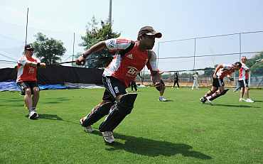 Samit Patel warms up with fitness coach Huw Bevan during a nets session