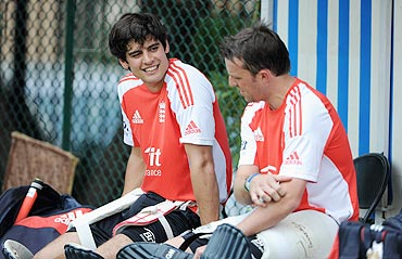 England captain Alastair Cook speaks with Graeme Swann.