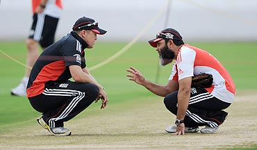 England coach Andy Flower speaks with spin bowling coach Mushtaq Ahmed at a nets session