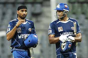 Harbhajan Singh with Andrew Symonds (right)