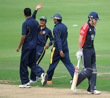 England's Alastair Cook leaves the field after being dismissed by Anwar Ahmed of Hyderabad XI during the tour match