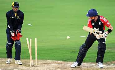 Graeme Swann is clean bowled during the tour match between England and Hyderabad XI