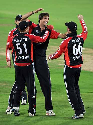 England's Steve Finn celebrates with teammates after picking up a wicket during their warm up tie against Hyderabad XI