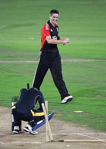 Chris Woakes celebrates after picking the wicket of Ibrahim Khaleel