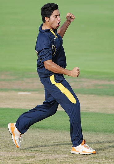Medhi Hasan of Hyderabad Cricket Association XI celebrates after dismissing Kevin Pietersen