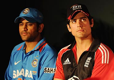 MS Dhoni (left) with Alistair Cook