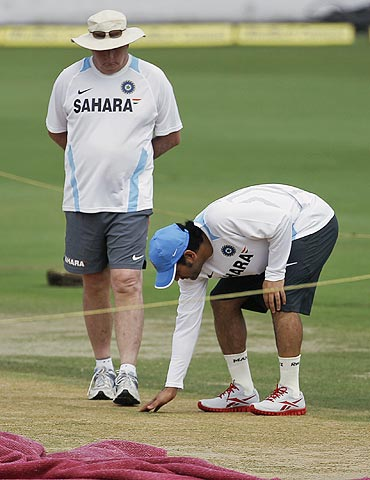 India's captain Mahendra Singh Dhoni (right) and coach Duncan Fletcher inspect the pitch in Hyderabad on Thursday