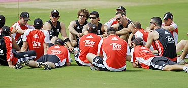 England team members sit in a group before a practice session in Hyderabad on Thursday