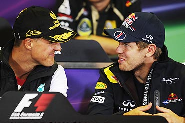 Sebastian Vettel (right) and Michael Schumacher