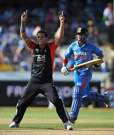 Jade Dernbach celebrates after dismissing Gautam Gambhir