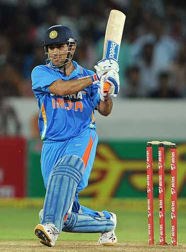 MS Dhoni plays a shot during h