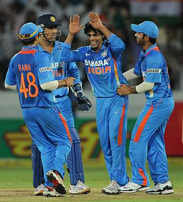 Ravindra Jadeja celebrates with teammates after picking up a wicket