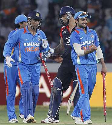 Indian players celebrate after winning the ODI