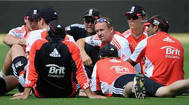 Coach Andy Flower speaks to the team during practice session