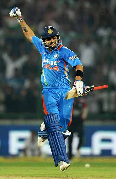 Virat Kohli celebrates after scoring a century against India