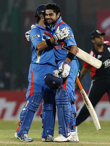 Gautam Gambhir and Virat Kohli celebrate after winning the match