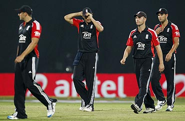 England's captain Alastair Cook (2nd from left) walks off the field with his team