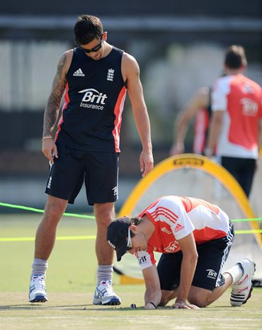 Jade Dernbach (L) and Steven Finn inspect the pitch