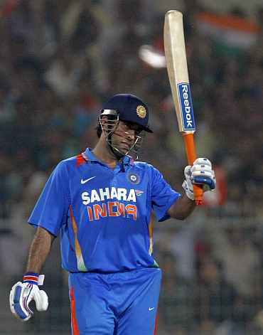 MS Dhoni reacts after reaching his half-century