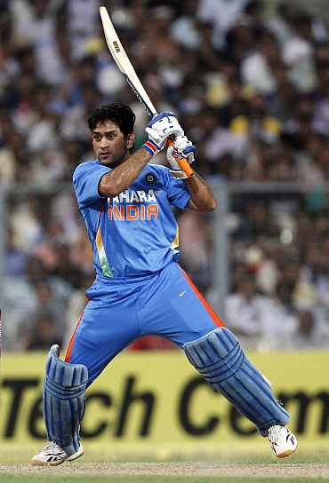 MS Dhoni hits a boundary during his knock against England