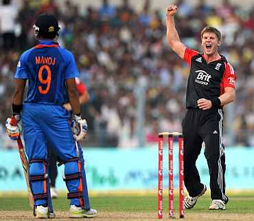 Stuart Meaker celebrates after bagging the wicket of Manoj Tiwary