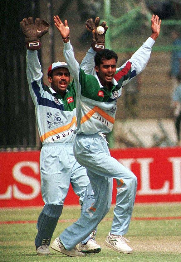 Indian keeper Syed Saba Karim and team-mate Nilesh Kulkarni (right)
