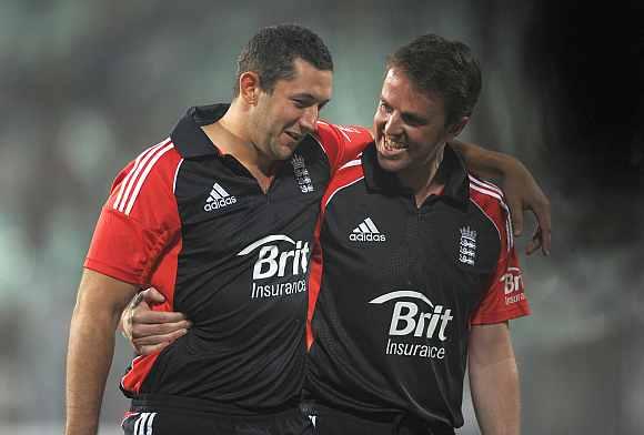 Graeme Swann celebrates with Tim Bresnan after won the Twenty20 match against India