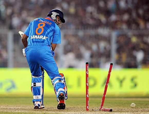 Praveen Kumar is clean bowled by Ravi Bopara