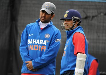 India captain M S Dhoni and Sachin Tendulkar in discussion at the nets