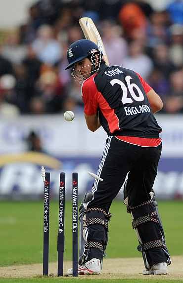 Alastair Cook is clean bowled by Praveen Kumar in the 1st ODI