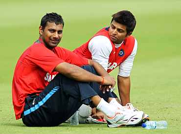 Praveen Kumar and Suresh Raina
