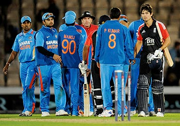 England captain Alastair Cook (right) meets India players after the match
