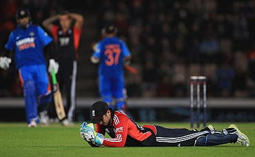Craig Kieswetter of England looks on as a ball goes to the boundary off Rahane's bat