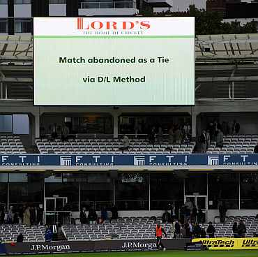 The big screen displays the decision to abandon the match as a tie via the Duckworth-Lewis method