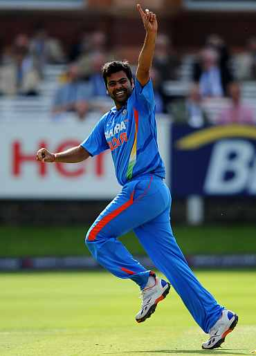 RP Singh celebrates after picking up a wicket