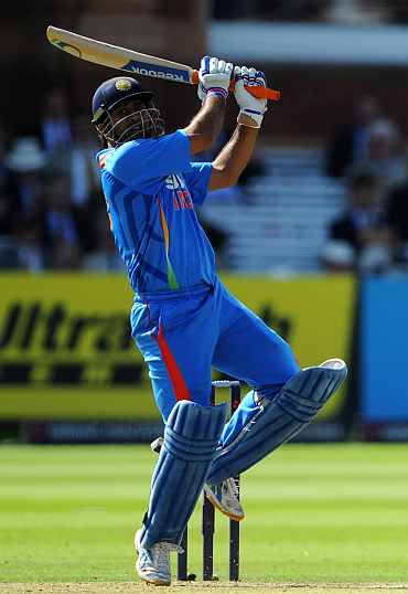 MS Dhoni hits a six during his knock against England