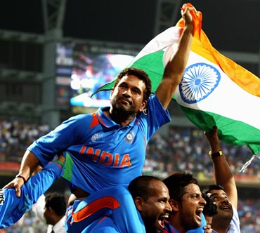 Sachin Tendulkar celebrates with team-mates after winning the 2011 World Cup