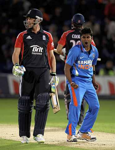 Vinay Kumar celebrates after picking up the wicket of Craig Kieswetter