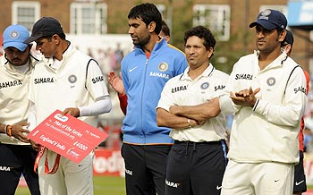 Indian players including Sachin Tendulkar (second right) and MS Dhoni (right) after the defeat in Test series against England