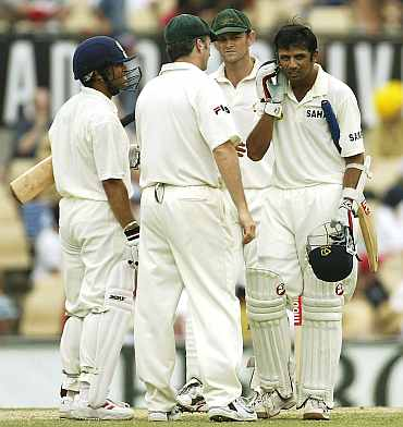 Rahul Dravid reacts after being hit by a Brett Lee delivery