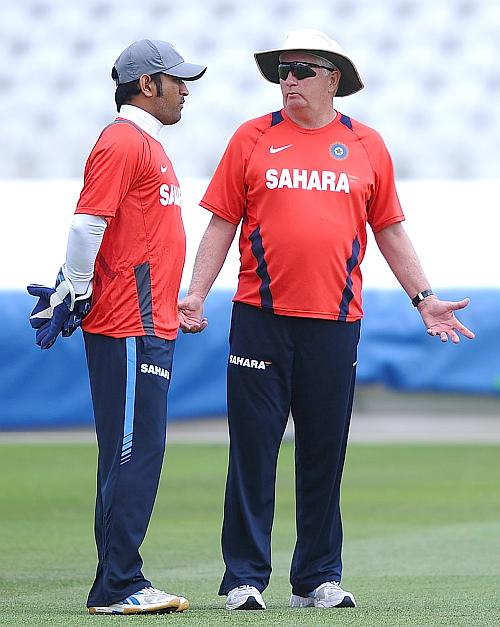 Mahendra Singh Dhoni of India talks with Duncan Fletcher