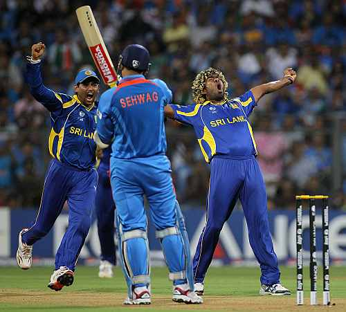 Lasith Malinga celebrates after picking up Virender Sehwag's wicket during the World Cup final