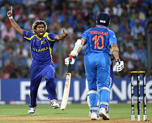 Lasith Malinga celebrates the wicket of Sachin Tendulkar during the World Cup final
