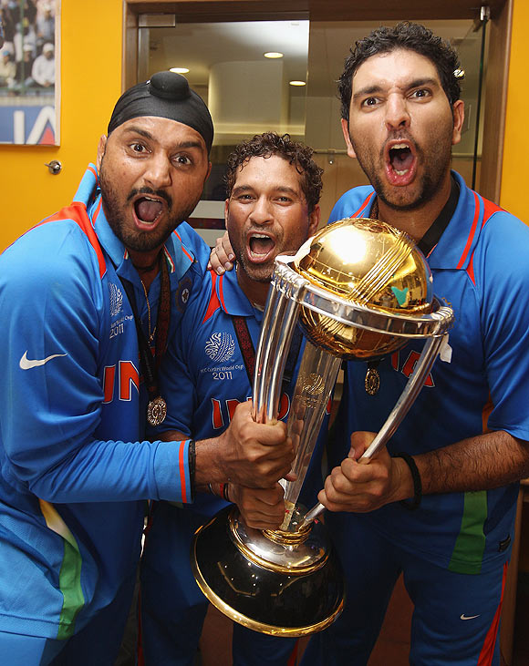 Yuvraj Singh, Sachin Tendulkar and Sachin Tendulkar celebrate after winning the World Cup
