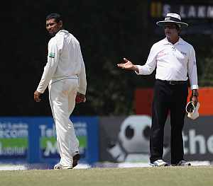 Tillakaratne Dilshan and Asad Rauf