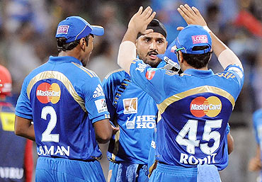 Mumbai Indians' skipper Harbhajan Singh with teammates