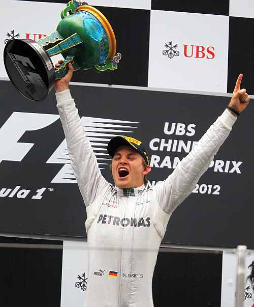 Nico Rosberg of Germany and Mercedes GP celebrates on the podium after winning the Chinese Formula One Grand Prix