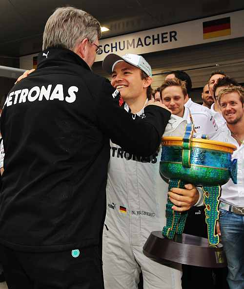 Race winner Nico Rosberg of Germany and Mercedes GP celebrates with team mates including his Team Principal Ross Brawn