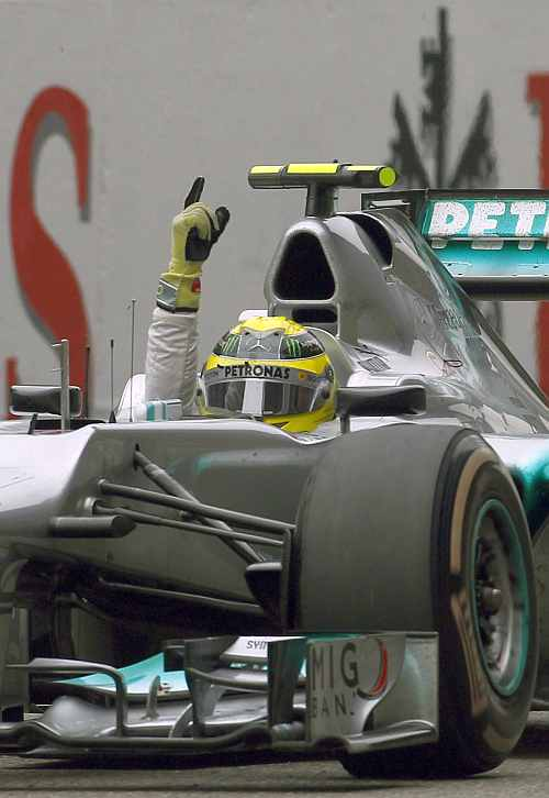 Mercedes Formula One driver Nico Rosberg celebrates winning the Chinese F1 Grand Prix at Shanghai circuit