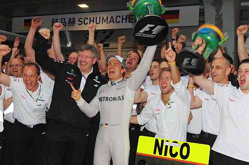 Race winner Nico Rosberg of Germany and Mercedes GP celebrates with team mates including his Team Principal Ross Brawn the pitlane following the Chinese Formula One Grand Prix